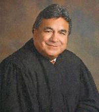 Judge is charged with bribery after criminal defense lawyer participates in sting operation