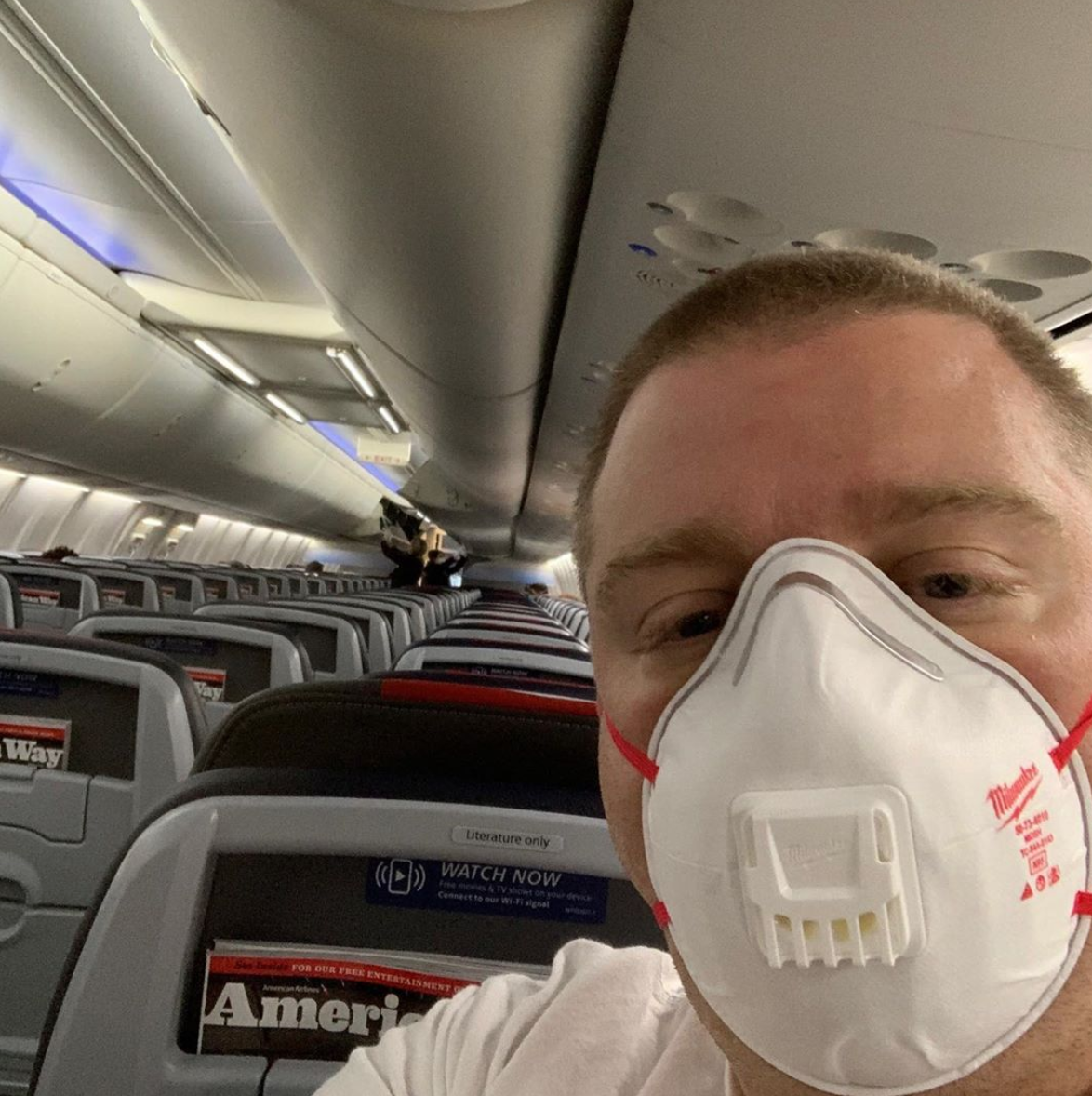Jim Mullen on empty plane in mask