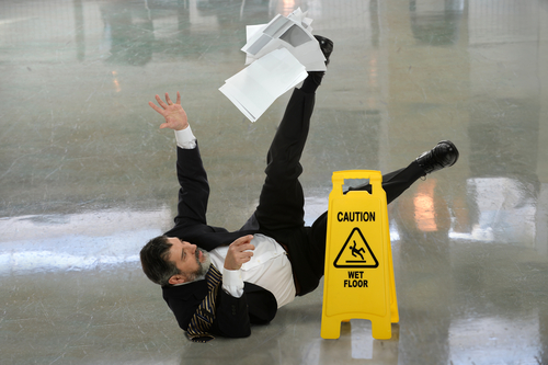 Photo of lawyer slipping on floor
