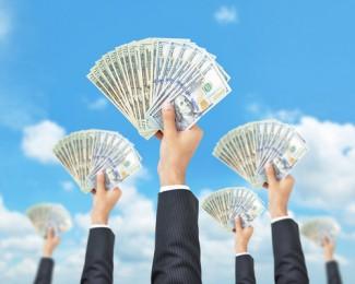 Hands holding money aloft