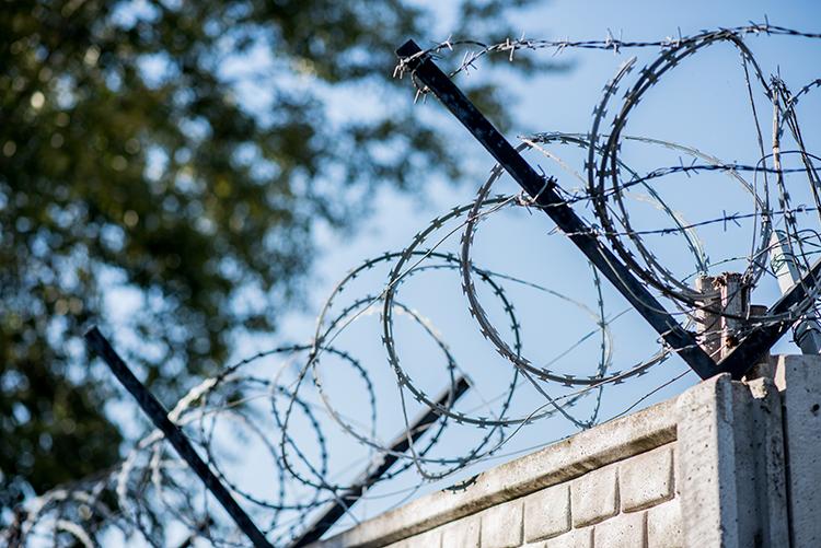 barbed wire on a prison fense