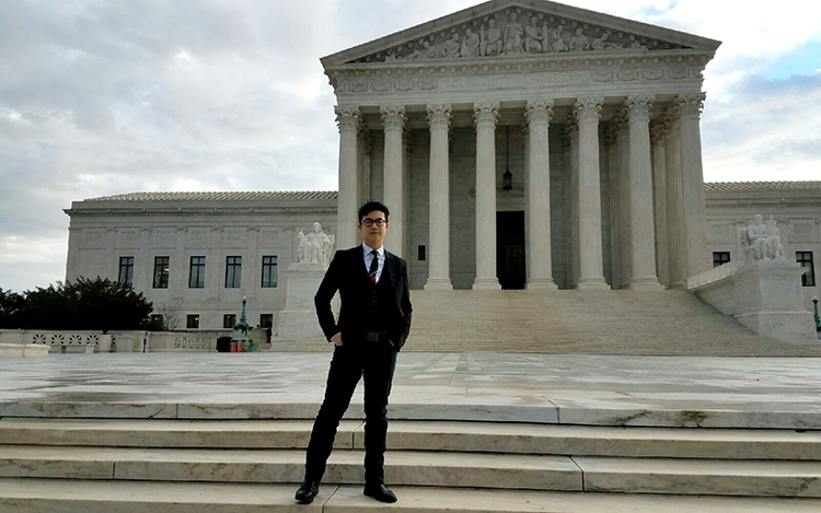 Simon Tam in front of the Supreme Court building.