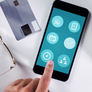 Finger pointing to app on smartphone