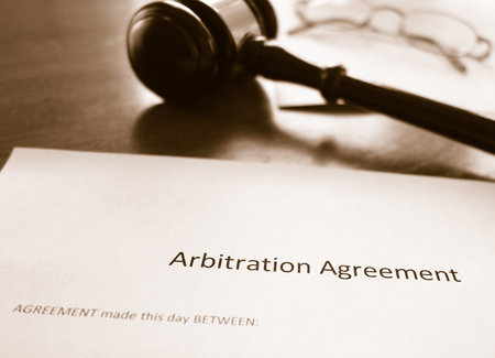 arbitration paperwork and a gavel.