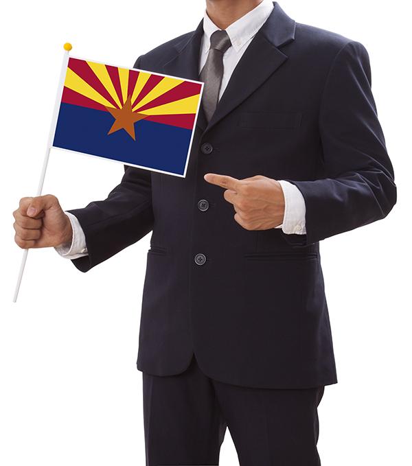 Businessman holding an Arizona state flag