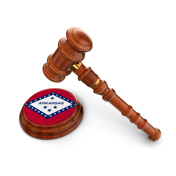 gavel with the arkansas state flag