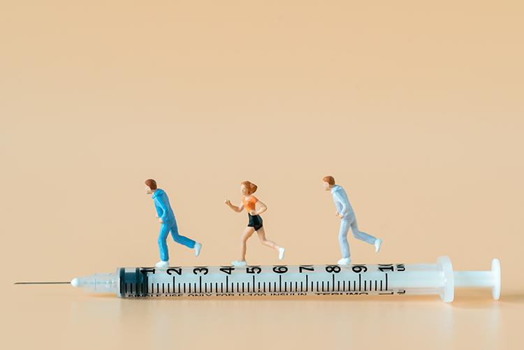 Athletes running on top of a syringe