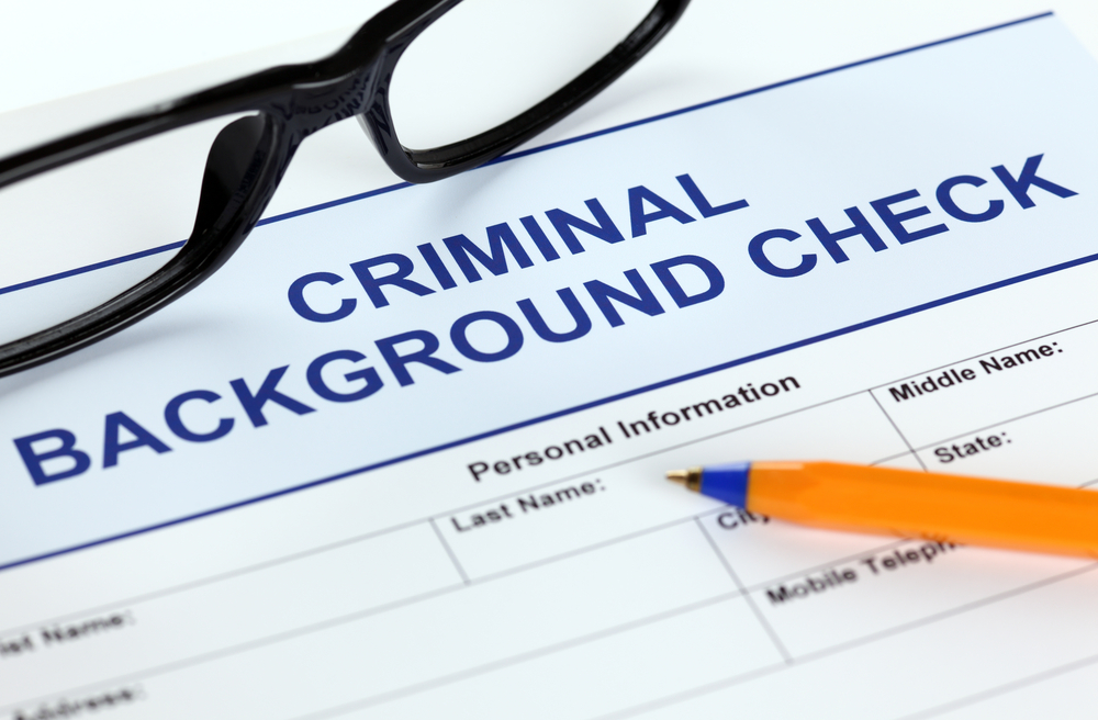 background check glasses pencil