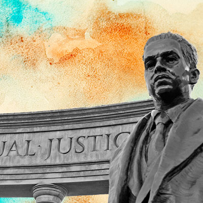 Statue of a man standing in front of a wall that says equal justice.