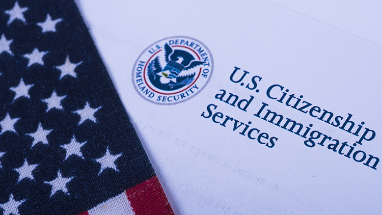 U.S. flag, Citizenship and Immigration Services logo.