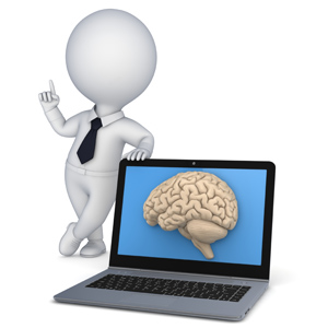 Man standing next to a computer with a brain shown on the screen