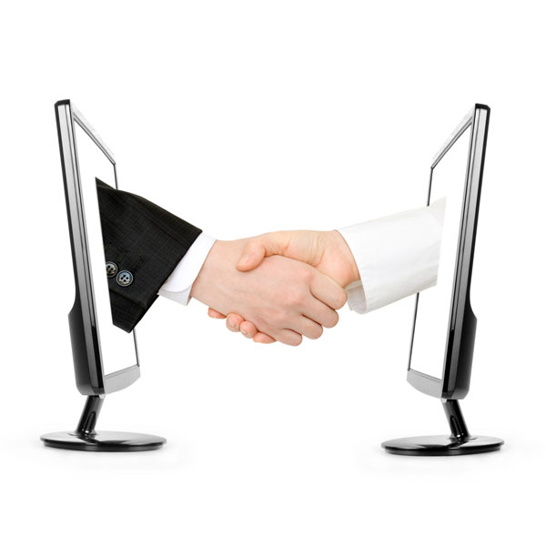 two people shaking hands through a computer screen