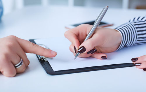 Woman being directed to sign a contract