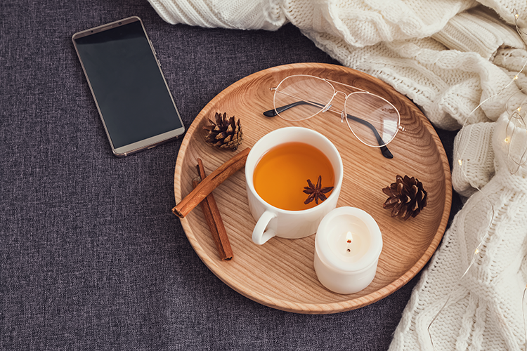 smartphone and cup of tea and glasses