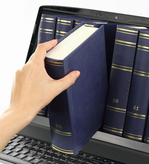 Hand is shelving law books inside a computer screen