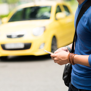Man texting in street while car approaches