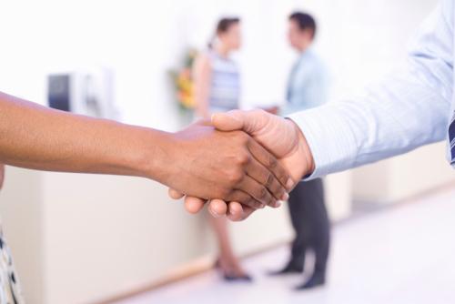 diverse hands shaking