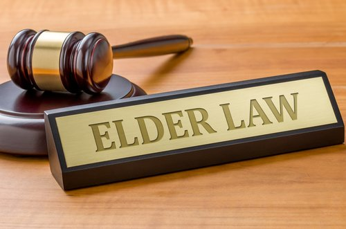 gavel and elder law sign
