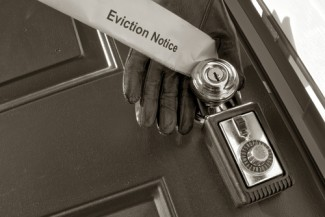 eviction notice with key in door