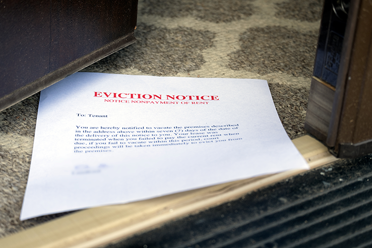 Eviction notice slid under a door