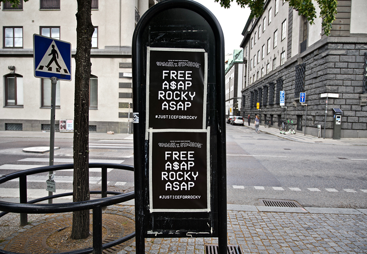 Mailbox in Stockholm with posters that say Free A$AP Rocky