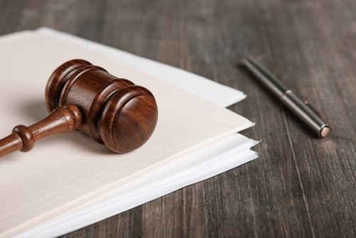 gavel paper and pen
