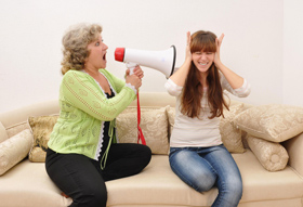 older woman yelling at younger woman