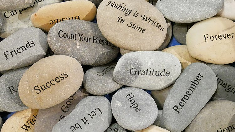 Stones marked with messages of gratitude.