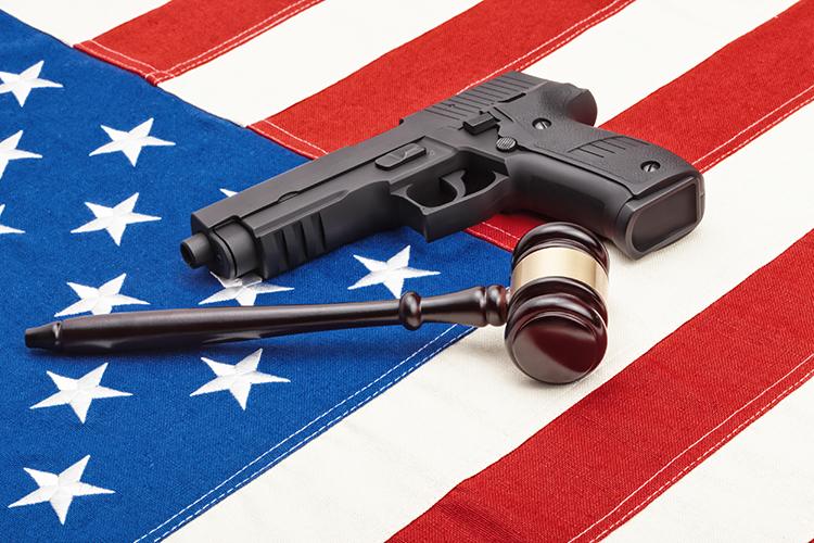 gun, gavel and American flag
