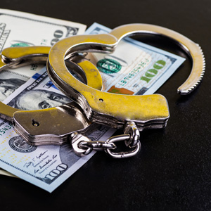 Handcuffs and money.