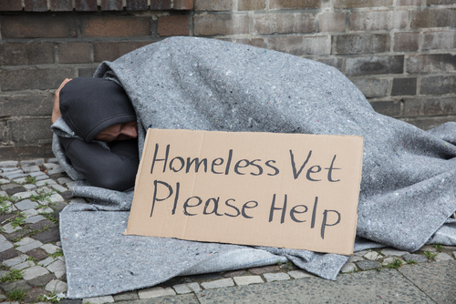 homeless veteran with sign