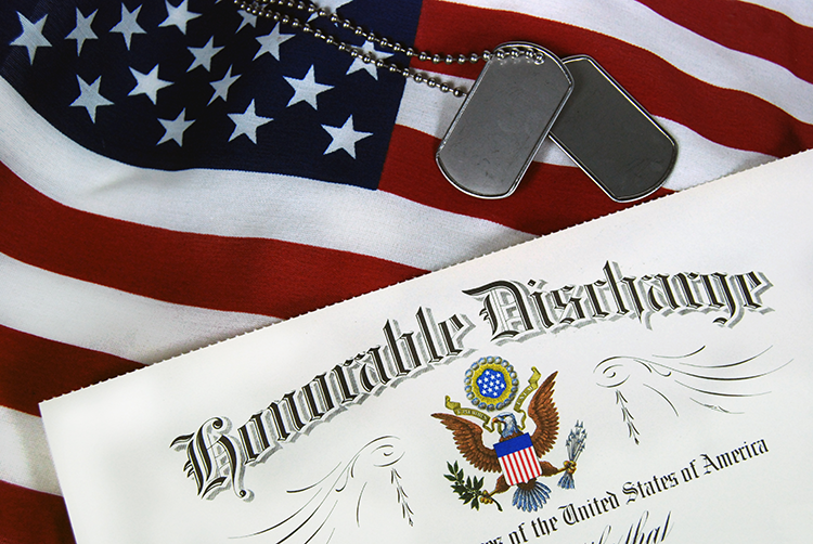 American flag and honorable discharge paperwork