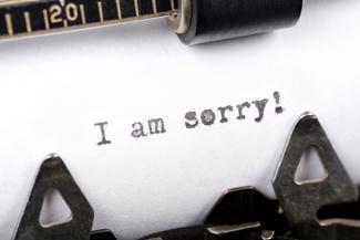 i am sorry words on typewriter