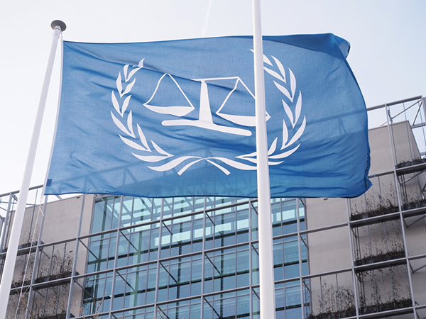 ICC flag outside building in The Hague