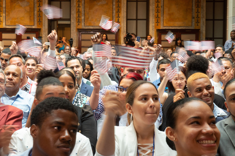 immigrationGettyImages group of people with flags