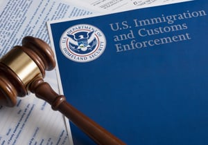 immigration papers and gavel
