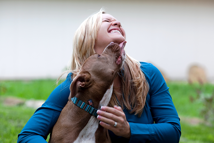 Katie Bray Barnett is licked on the face by her rescue dog Leonidas