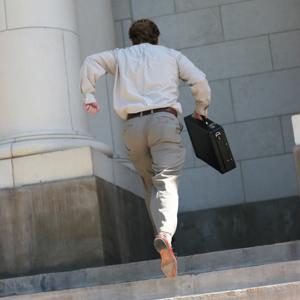 Man running up court steps