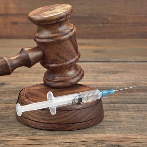 Gavel and syringe.