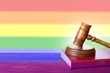 LGBTQ flag and gavel