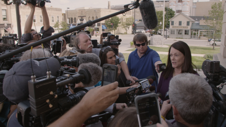 Kathleen Zellner addresses a crowd of reporters