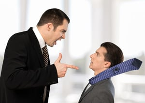 man bullying co-worker