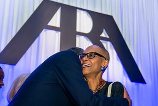 Emma Coleman Jordan is hugged during awards ceremony