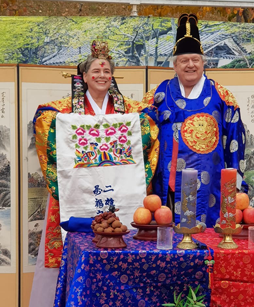 Mary and Gay wearing traditional Korean garments