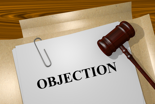 gavel and folder with objection words