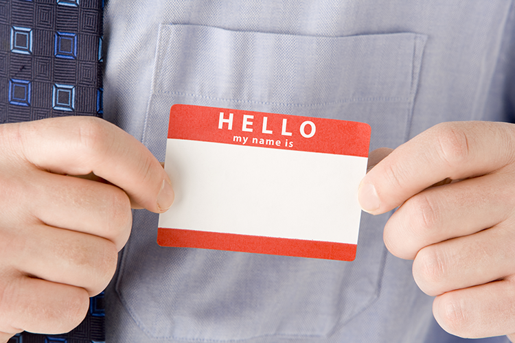 Person putting on nametag