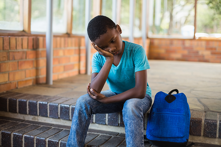 Young Black student who is sad