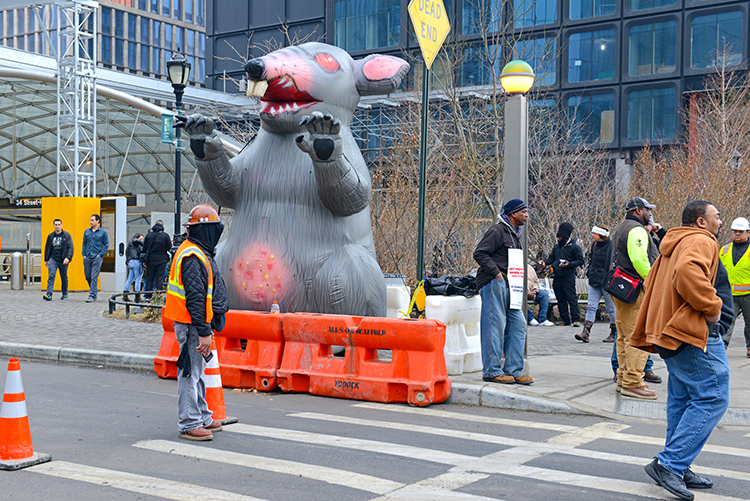 Scabby the rat attends a protest