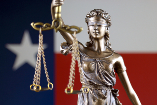 Texas flag and Lady Justice