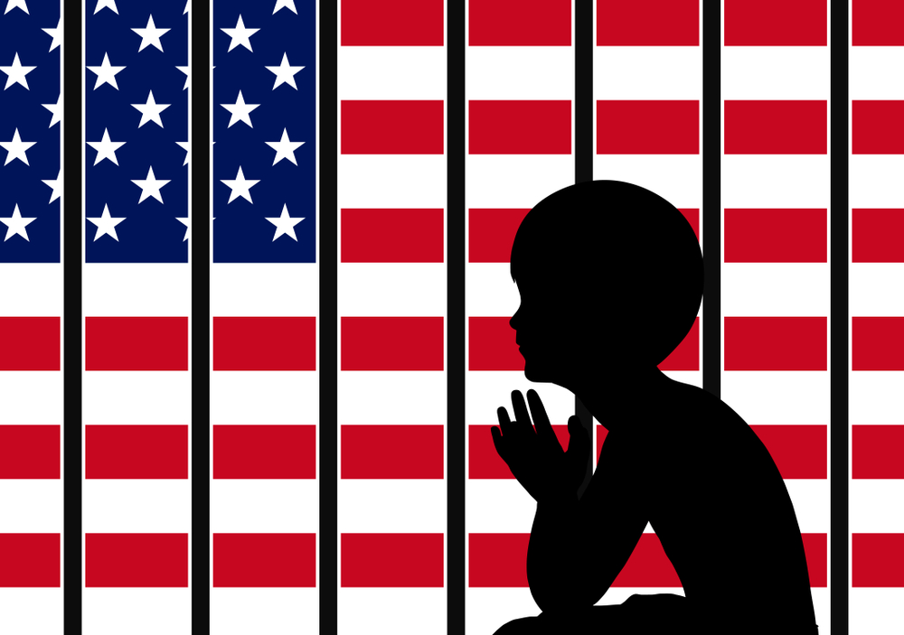 child immigrant behind bars and flag